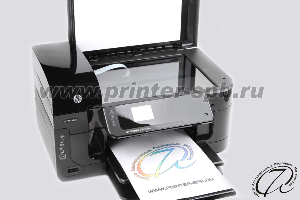 МФУ HP Officejet 6500A с открытой крышкой сканера